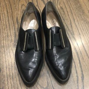 Black and gold pointed toe oxfords